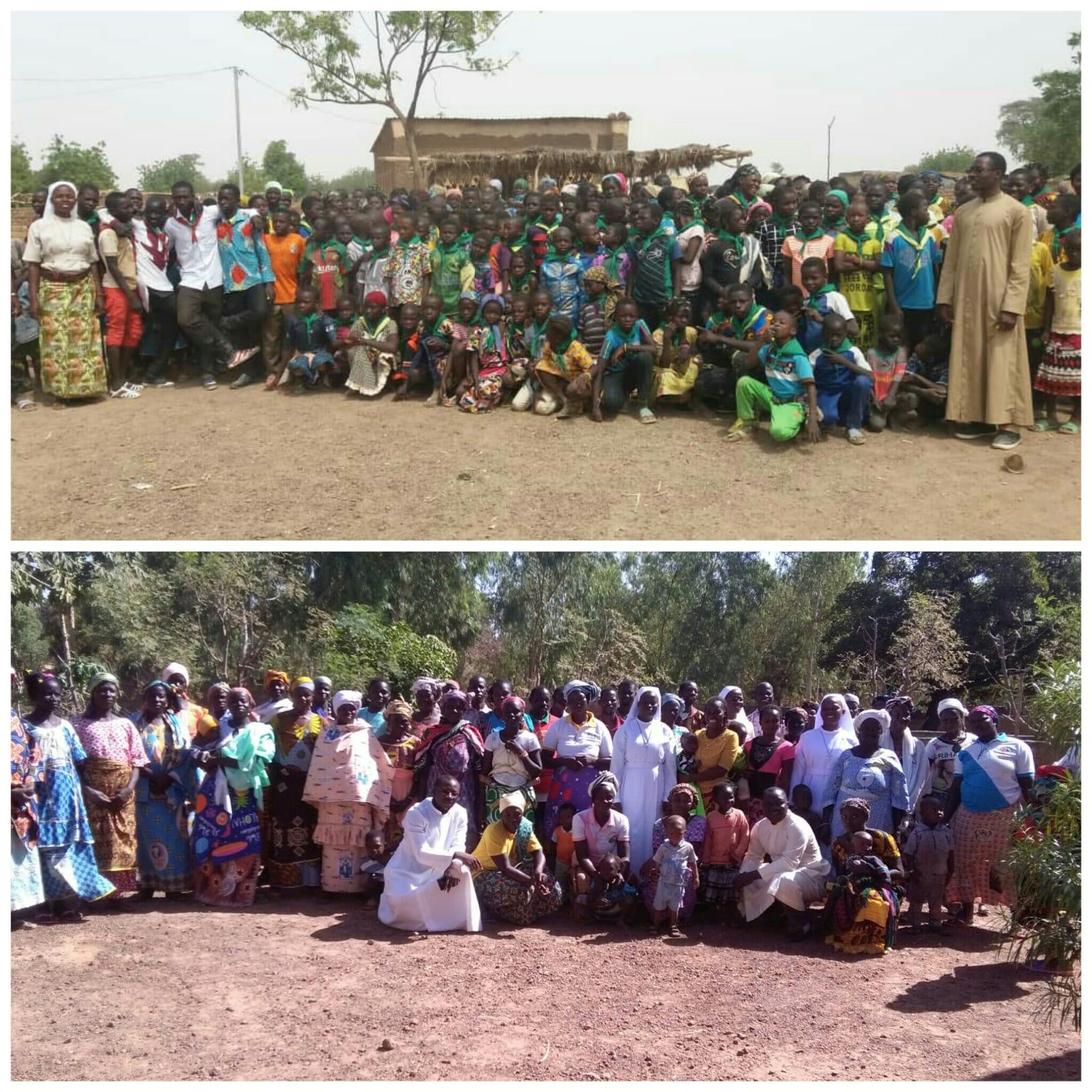 Kinder und Frauen, die von den Schwestern begleitet werden.
