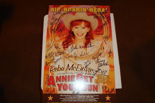Poster signed by the cast. Nick's autograph is by Reba's right side (our left), by her hair. 'Blaire' is written below it. Thanks ebay!