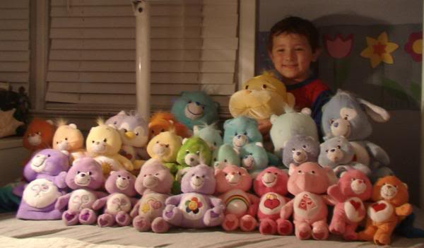 Lost in the middle of all his stuffed animals.