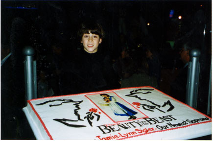 Nick with the welcoming cake to Jamie-Lynn Sigler. Her opening party, Wednesday, October 23rd 2002 - Credit nicholasjonas.com