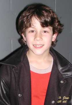 Nicholas visits his friends at the opening night of A Christmas Carol at MSG, November 23rd, 2001. He was wearing his A Christmas Carol jacket, which says 'Nicholas Jonas - Scrooge at 8' - Credit ACC kids