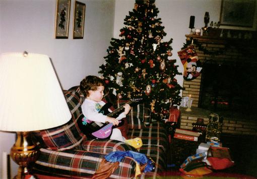 Baby Nick having fun with his Christmas gift.