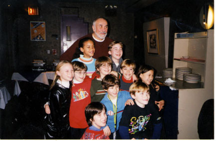 Nick with Frank Langella, Patrick Stogner (standing to Nick's right, in red with glasses), Gerard Canonico (in green, behind Nick), Amelia Harris (the tallest girl, on Mr. Langella's right) and the other kids from the musical. - credit nicholasjonas.com