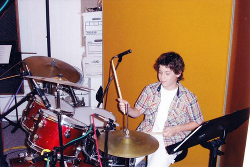 Nick in the studio playing the drums - Credit SRP