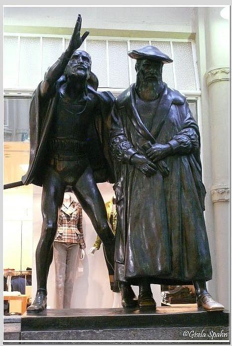 "Am Eingang: Szene in Auerbachs-Keller (aus Goethes ""Faust"": Mephisto verzaubert die Studenten)"