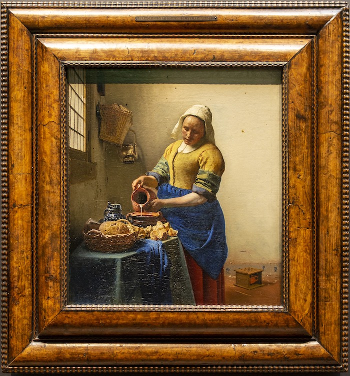 Johannes Vermeer painting The Milkmaid