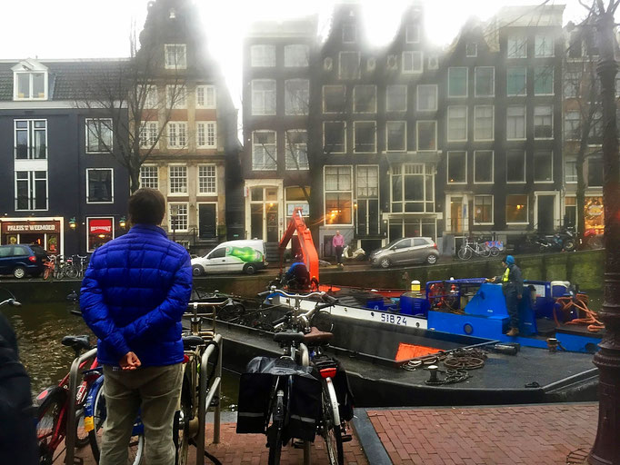 crane removing bikes from canals in amsterdam holland