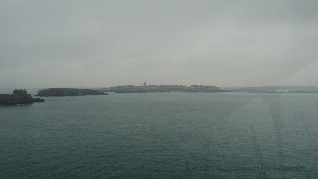 Saint-Malo city center, the Petit Bé (foreground) and the Grand Bé (middleground) by high tide