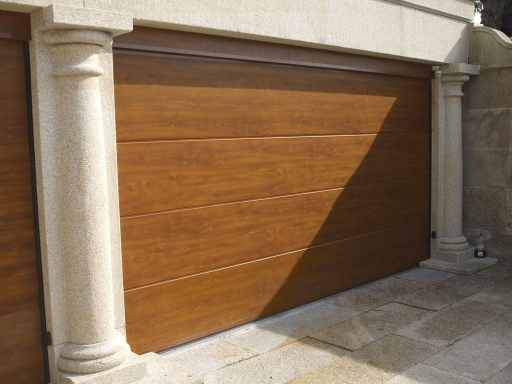 Puertas de garaje portones y automatismos alemar for Puertas abatibles garaje