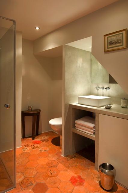 conception d'une salle de bain en béton ciré.