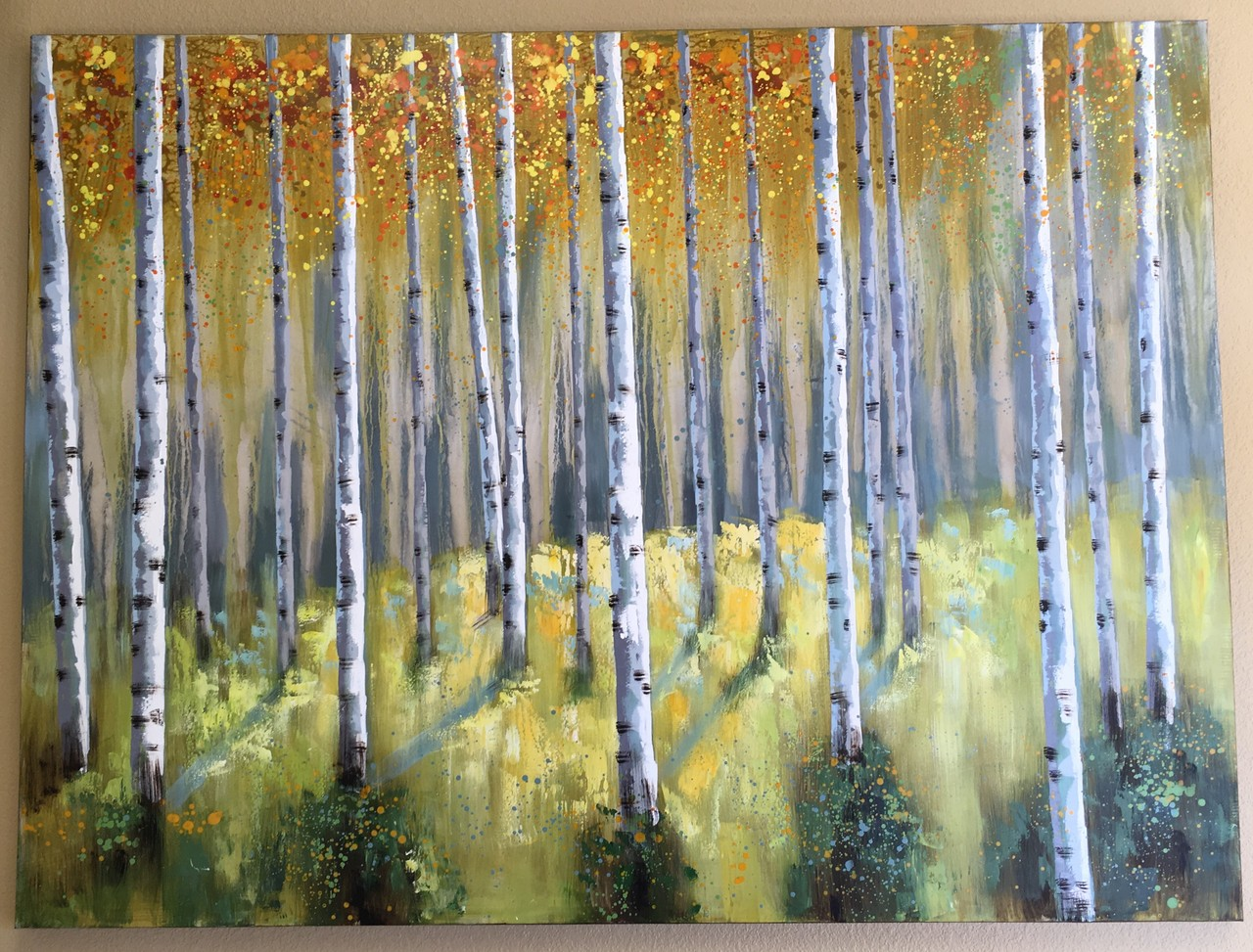 The Aspen painting hanging in our waiting room reflects our admiration for our beloved state. We are Colorado proud!