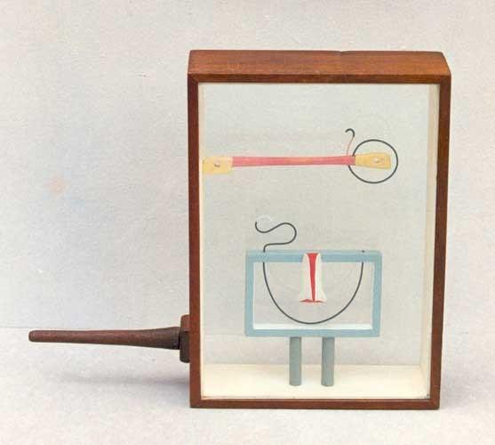 MIRÓN. 1989. 20 x 14 x 4,5 cm. Madera y metal.