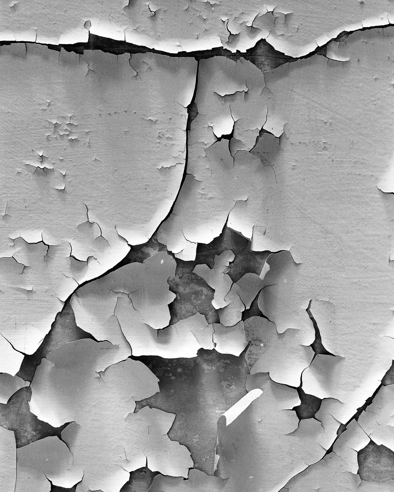 Peeling paint on facade, place unknown