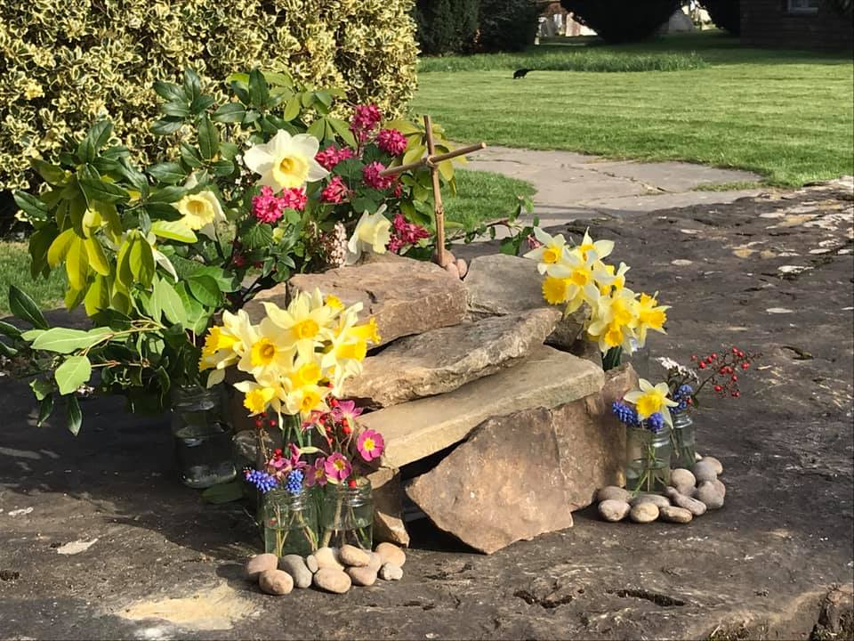 The mini Easter garden was laid out on the churchyard stone...