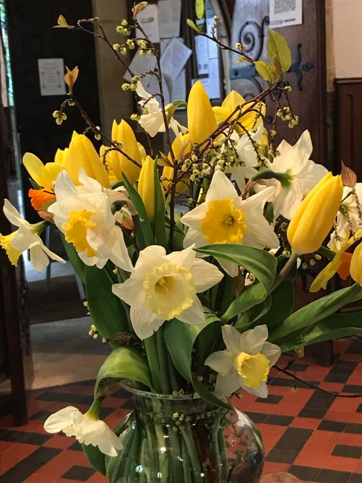 The scent of daffodils filled the church
