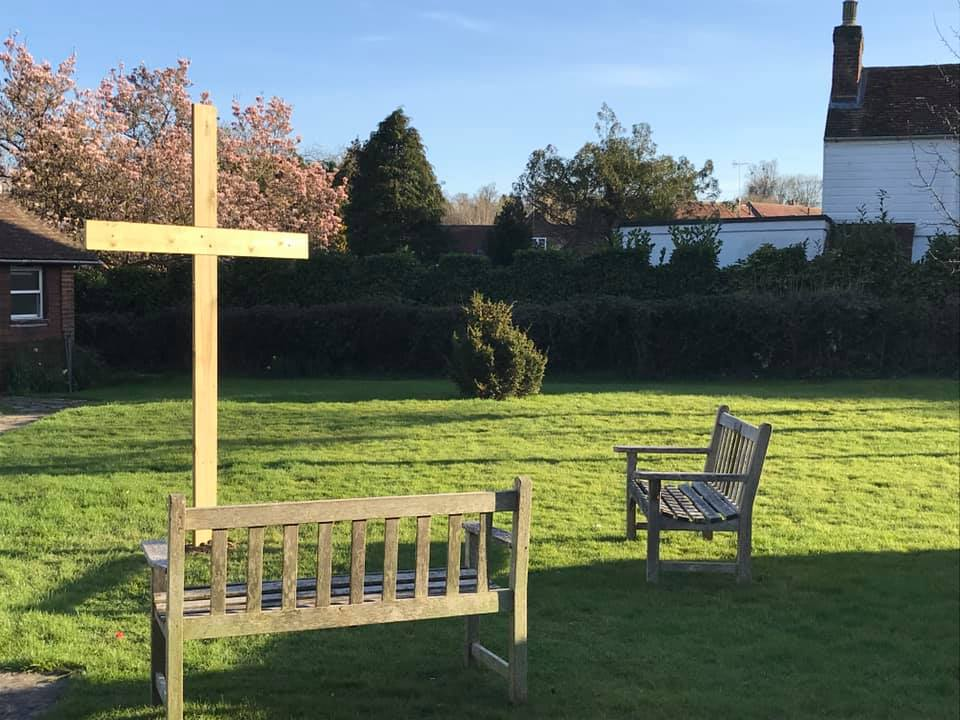 A cross was erected on the church lawn with seats positioned inviting people to stop and contemplate