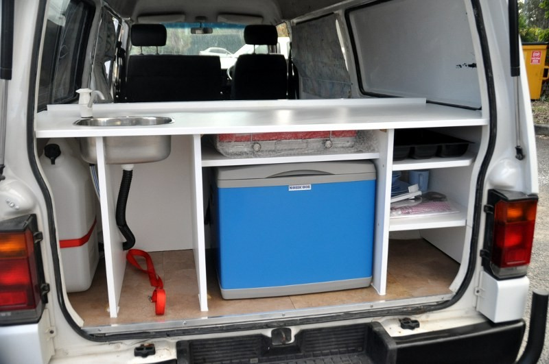 simple kitchen with fridge space, stainless steel sink-  bouns:  your are sheltered by the tailgate