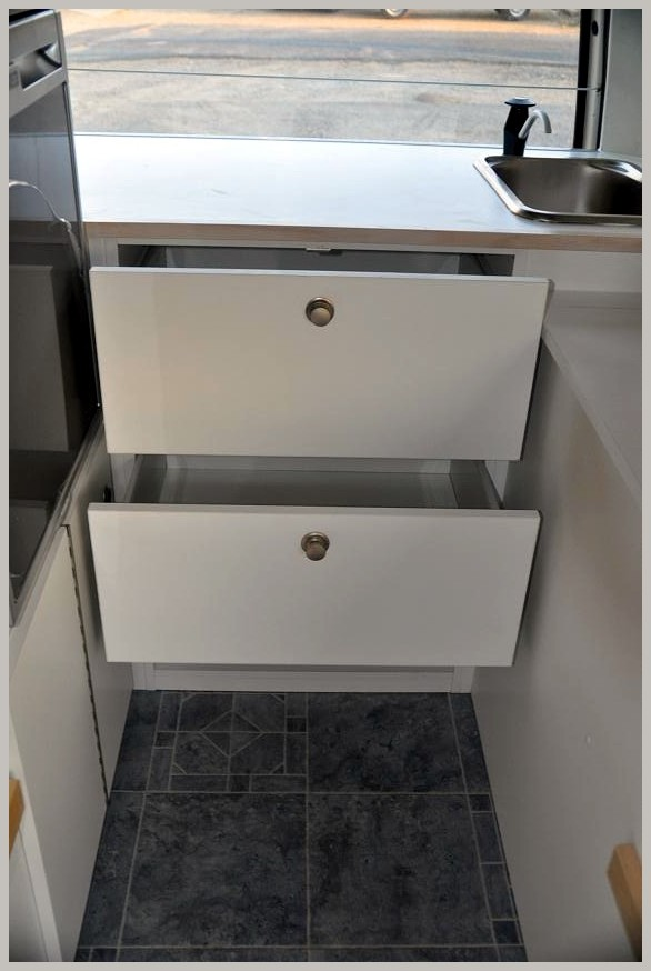 set of drawers in kitchen area
