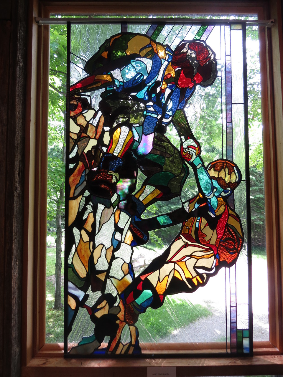 HELPING HAND 24 x 44 inches stained glass, photo by Lloyd Howell