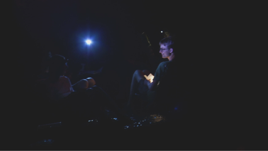 Reading by flashlight while sitting in the river.  © 2013 First Pictures.  All rights reserved.