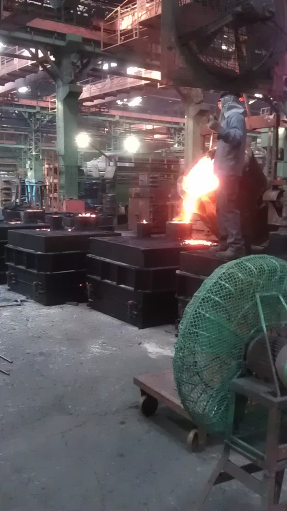 Into the sand mould