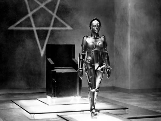 Metropolis (1927) Szenenfoto von der Maschinen-Maria in Rotwangs Labor, im Hintergrund der Hexenfuß (Fünfzack)