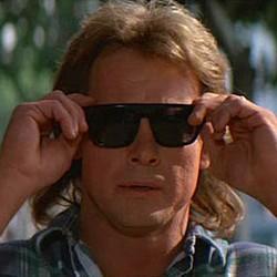 """Szenenfoto aus dem Film """"Sie leben"""" (They Live, USA 1988) von John Carpenter; Roddy Piper"""