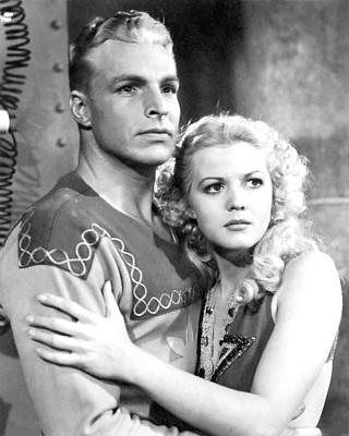 "Szenenfoto aus dem Kinoserial ""Flash Gordon"" (USA 1936); Larry Buster Crabbe und Jean Rogers"