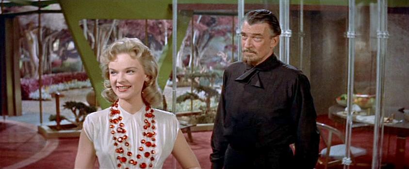 """Szenenfoto aus dem Film """"Alarm im Weltall"""" (Forbidden Planet, USA 1956) von Fred McLeod Wilcox; Anne Francis und Walter Pidgeon"""