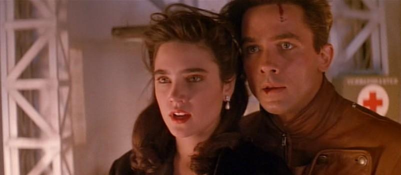 """Szenenfoto aus """"Rocketeer"""" (1991) von Joe Johnston; Jennifer Connelly und Bruce Campbell"""
