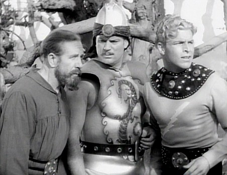"Szenenfoto aus dem Kinoserial ""Flash Gordon's Trip to Mars"" (USA 1938); Frank Shannon, Richard Alexander und Larry Buster Crabbe"