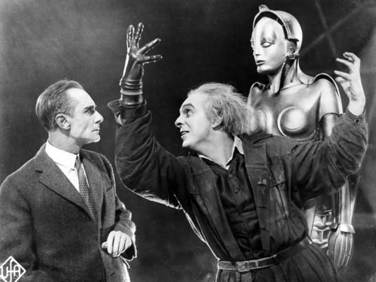 Metropolis (1927) Szenenfoto mit Alfred Abel, Rudolf Klein-Rogge und Brigitte Helm als Fredersen, Rotwang und Maschinen-Maria