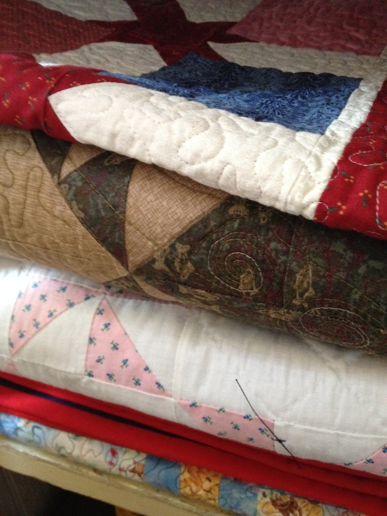 Collection of traditional quilts Photo credit: Amy Mundinger