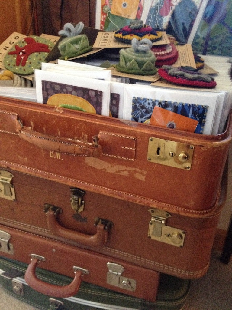 Vintage suitcases for product display Photo credit: Amy Mundinger