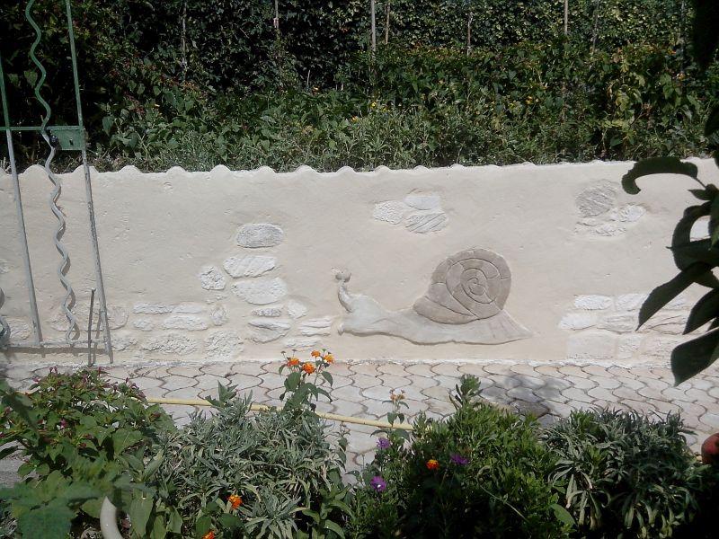Mur enduit pierre. Nîmes