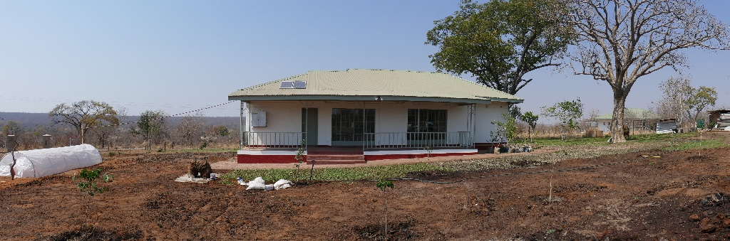 The back view with the new fully operation biodigester energy unit to the left of the building