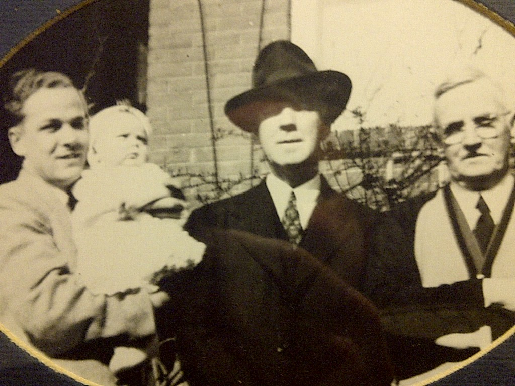 From the left is Wilfred Joseph Wheater holding son Wilfred Gary. Next Gary's grandfather William Gerrard Joseph and on the right is James Wheater William's father who came from England to Canada.