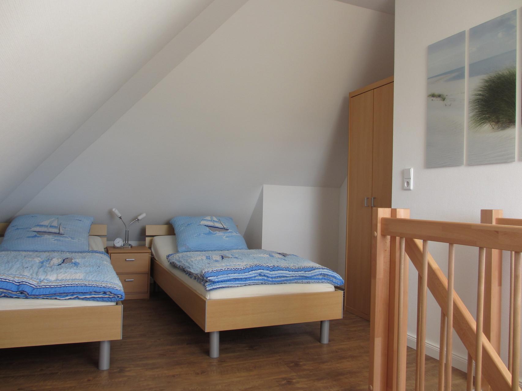 Galerie mit zwei Einzelbetten, können auch gerne zusammen gestellt werden