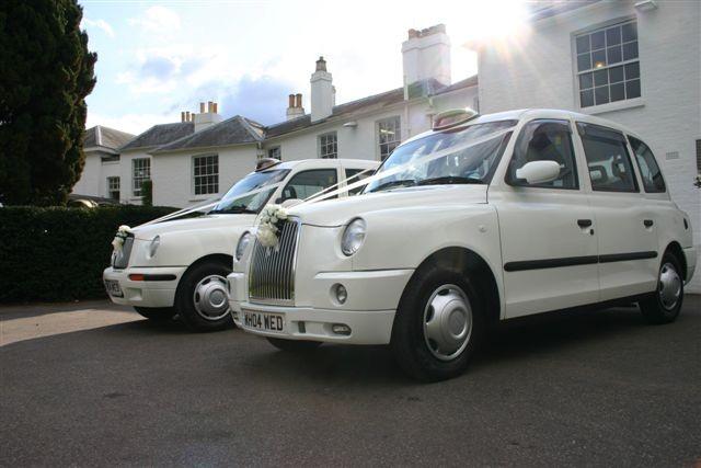 modern white wedding taxis