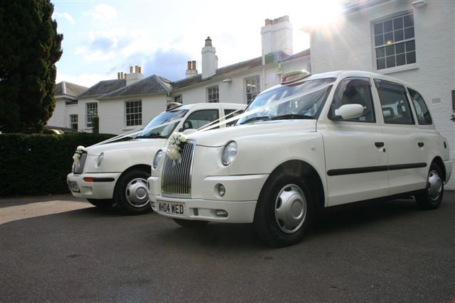 modern white wedding taxis
