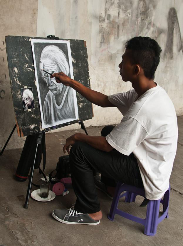 Strassenmaler im Ortsteil Kota