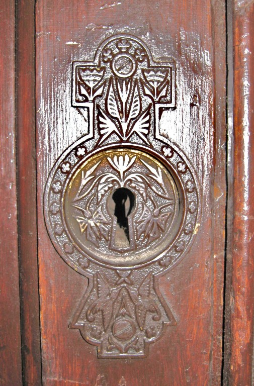 close up of key hole on pocket doors on second floor