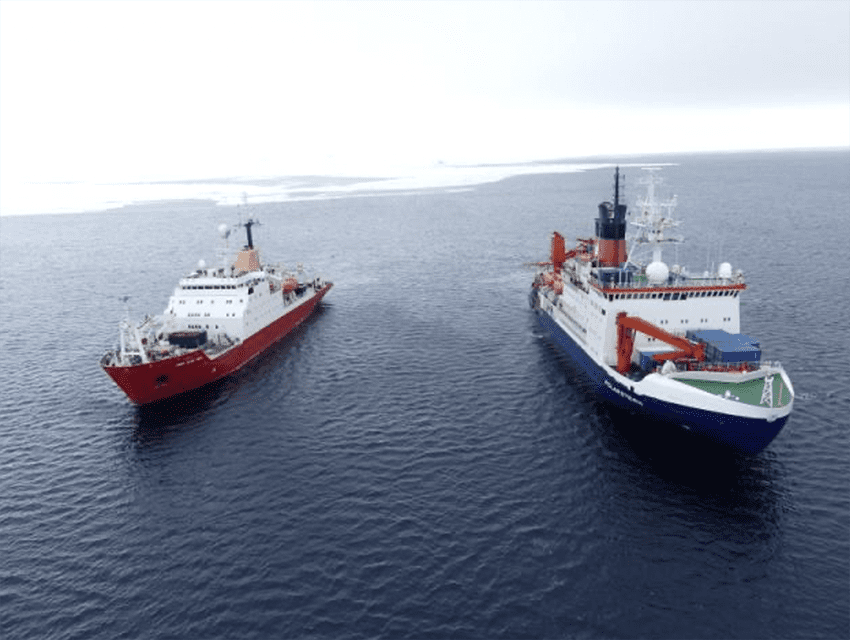 The research vessels RRS James Clark Ross and RV Polarstern meeting 2018 in the sea ice-covered Southern Ocean. Photo courtesy Michael Gischler