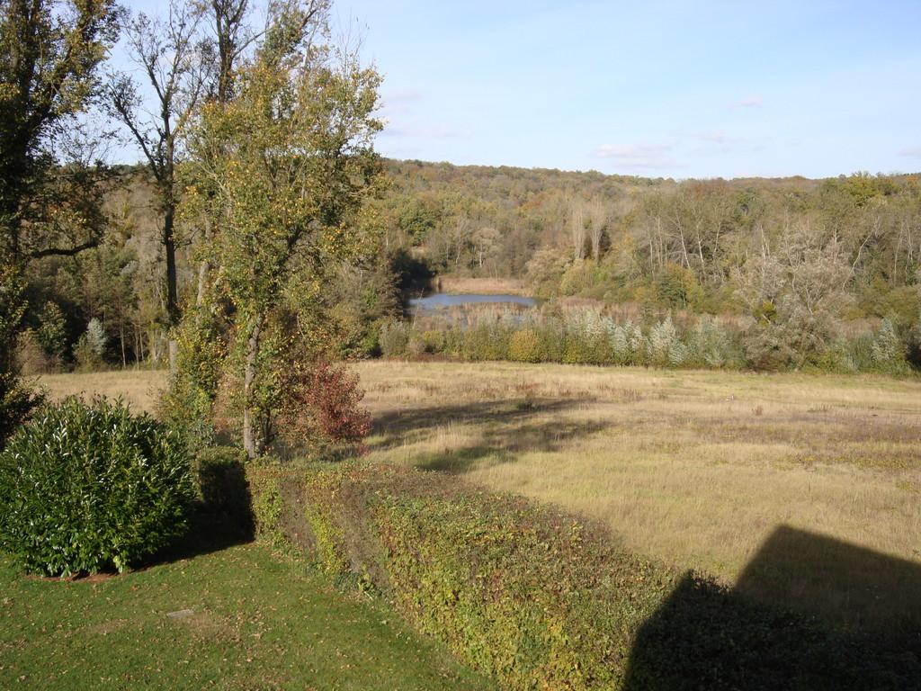 Vue sur l'étang du Château de REILLY - Chambre d'hôtes à Reilly