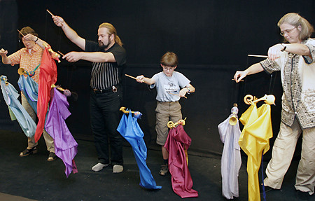 Group dancing with cloth figures