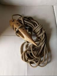 la clé à foin pour tenir grâce au cordage