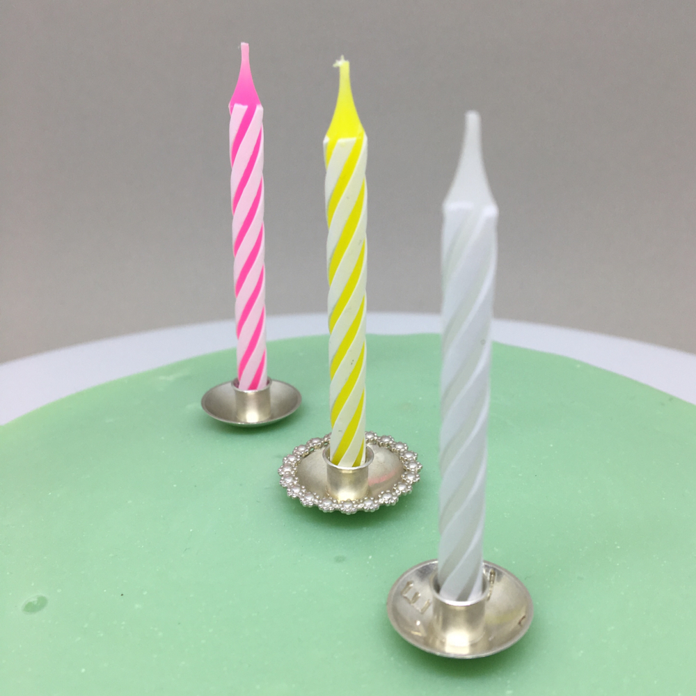 Smuggle your cake with customized cak candle holders.
