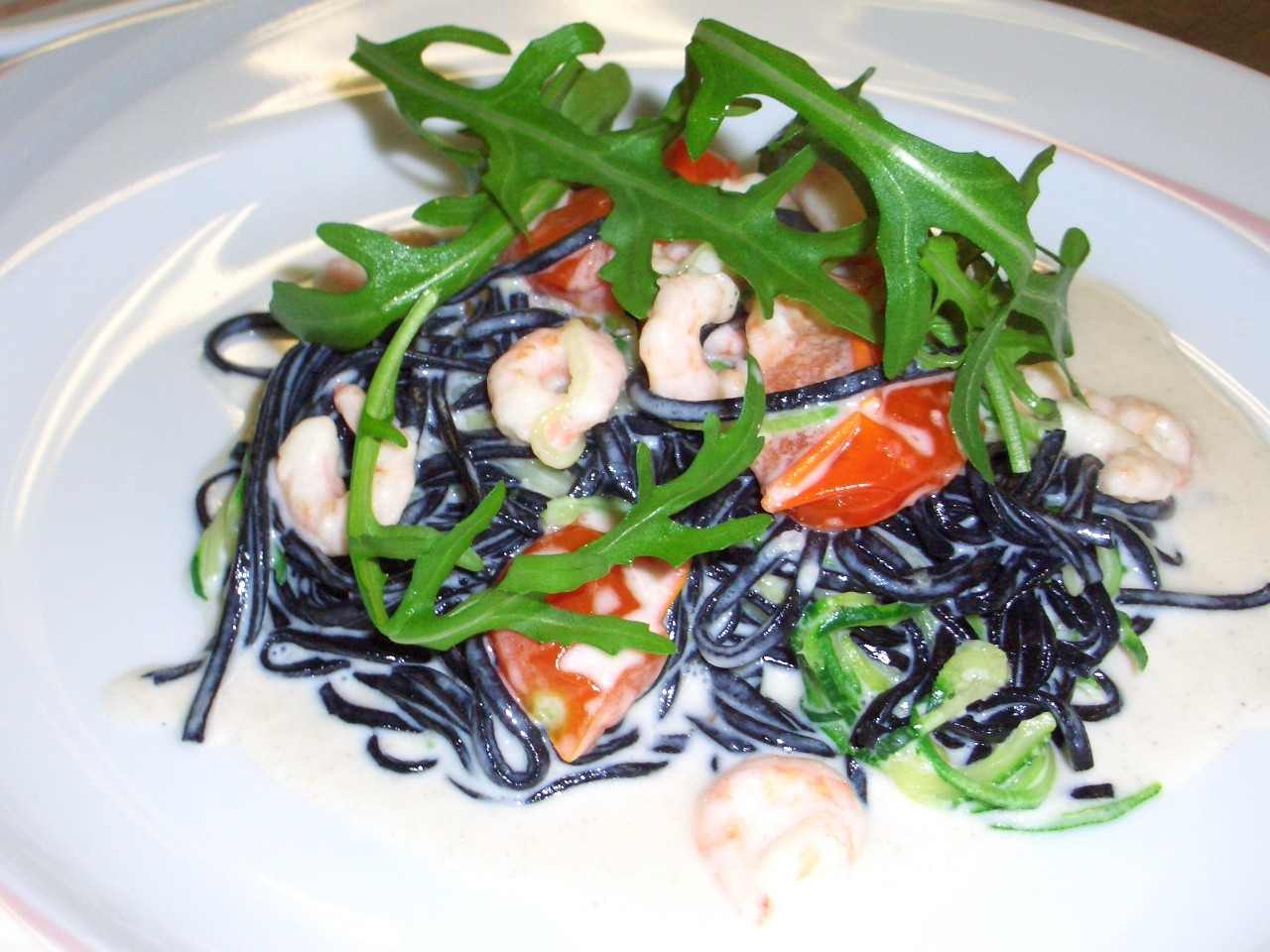 Tagliatelle of squid ink with prawns