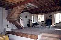 Escalier à noyau avec volute de départ et balustres en bois tourné