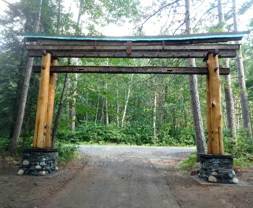 A Torii inspired entry made from old hand hewn barn beams